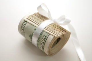 Dollar roll tightened with ribbon