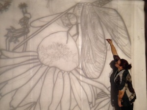 Tracing the design of the mural at actual size