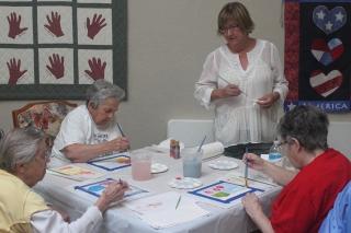 Art Committee Chair, Linda Eyermann, leads seniors at St. Agnes Senior Living Center.
